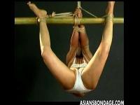 下着姿で緊縛され吊るされて放置プレイされる美人妻。